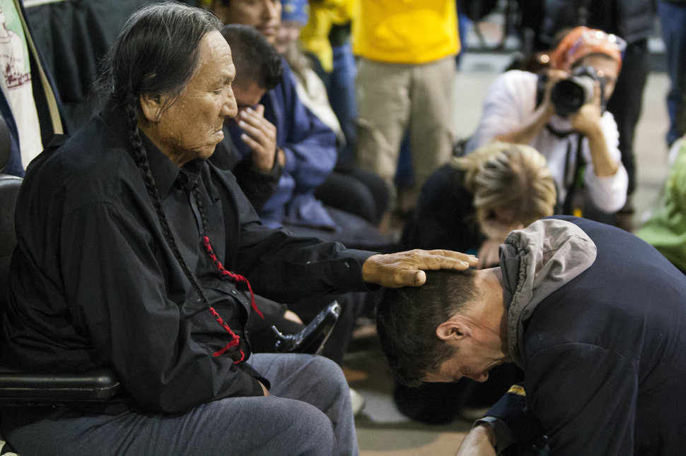 Lakota elder Leonard Crow Dog accepts the apology of US veteran Wesley Clark Jr. during a forgiveness ceremony conducted by Native Americans and US veterans at the Standing Rock Sioux Reservation in North Dakota on December 5, 2016, one day after the US Army Corps of Engineers acknowledged the claims of water protectors and halted construction of the Dakota Access Pipeline pending a full Environmental Impact Statement.